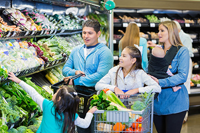 Man and women grocery shopping with children